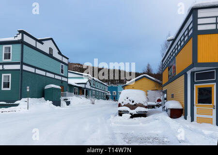 DAWSON CITY, YUKON, CANADA, March 11, 2019 : A snowy street. Dawson City is linked to the Klondike Gold Rush and featured prominently in the novels of - Stock Photo