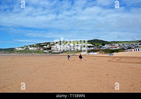 Two ladies walking dogs on Woolacombe Beach, Woolacombe Bay, Devon, UK - Stock Photo