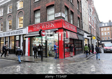 The Week newsagent shop on the corner of Berwick street on a rainy day  in Soho London UK  KATHY DEWITT - Stock Photo