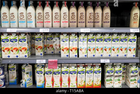 A variety of dairy free vegan health drinks in cartons and bottles on a refrigeration shelf at Waitrose supermarket in London England UK  KATHY DEWITT - Stock Photo