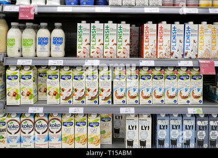 Lactose dairy free vegan health drinks in cartons and bottles on a refrigeration shelf at Waitrose supermarket in London England UK  KATHY DEWITT - Stock Photo