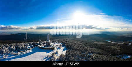 Germany, Hesse, Schmitten, Aerial view of Grosser Feldberg, aerial mast of hr and viewing tower in winter - Stock Photo