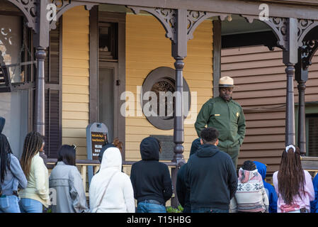 National Park Service ranger speaking with tour group at the birth home of Martin Luther King, Jr. on Auburn Avenue in Atlanta, Georgia. (USA)