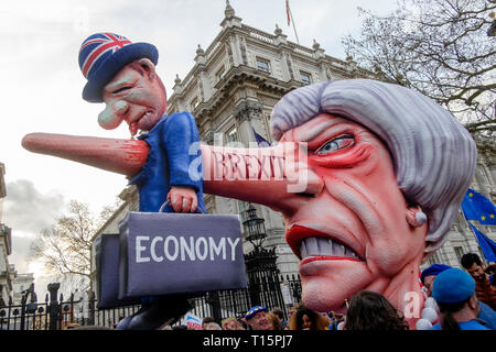 London, UK. 23rd March 2019. Hundreds of thousands of people march through central London demanding a second vote on the UK's membership of the European Union. Pictured: A float depicting Theresa May and the effect Brexit will have on the British economy is positioned at the entrance to Downing Street. Credit: mark phillips/Alamy Live News - Stock Photo