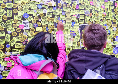 London, UK. 23rd March 2019. Hundreds of thousands of people march through central London demanding a second vote on the UK's membership of the European Union. Pictured: Pro EU Remainers post hundreds of anti-Brexit stickers on doors of the UK Government Cabinet Office building in Whitehall. Credit: mark phillips/Alamy Live News - Stock Photo