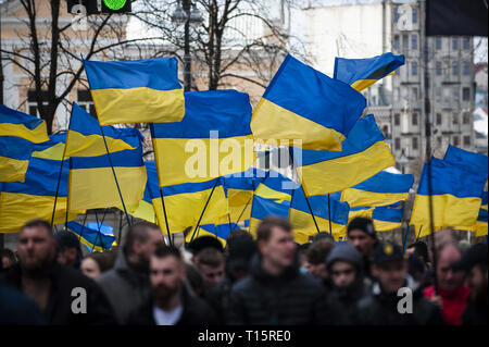 Kyiv, Kyiv Oblast, Ukraine. 23rd Mar, 2019. Flags seen among protesters in Maidan Square during the demonstration. Protesters gathered in Maidan Square then marched to the Presidential Administration building to call on President Petro Poroshenko to bring corrupt governmental officials to justice. With the Ukrainian Elections being held at the end of March the political tensions run very high. Credit: Matthew Hatcher/SOPA Images/ZUMA Wire/Alamy Live News - Stock Photo