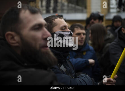 Kyiv, Kyiv Oblast, Ukraine. 23rd Mar, 2019. A protester seen with a face mask during the demonstration. Protesters gathered in Maidan Square then marched to the Presidential Administration building to call on President Petro Poroshenko to bring corrupt governmental officials to justice. With the Ukrainian Elections being held at the end of March the political tensions run very high. Credit: Matthew Hatcher/SOPA Images/ZUMA Wire/Alamy Live News - Stock Photo