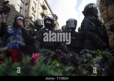 Kyiv, Kyiv Oblast, Ukraine. 23rd Mar, 2019. Pile of bouquets of plastic flowers at thrown at police in riot gear seen during the demonstration. Protesters gathered in Maidan Square then marched to the Presidential Administration building to call on President Petro Poroshenko to bring corrupt governmental officials to justice. With the Ukrainian Elections being held at the end of March the political tensions run very high. Credit: Matthew Hatcher/SOPA Images/ZUMA Wire/Alamy Live News - Stock Photo