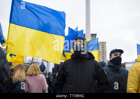 Kyiv, Kyiv Oblast, Ukraine. 23rd Mar, 2019. Protesters seen lined up in Maidan Square to march to the Presidential Administration Building during the demonstration. Protesters gathered in Maidan Square then marched to the Presidential Administration building to call on President Petro Poroshenko to bring corrupt governmental officials to justice. With the Ukrainian Elections being held at the end of March the political tensions run very high. Credit: Matthew Hatcher/SOPA Images/ZUMA Wire/Alamy Live News - Stock Photo
