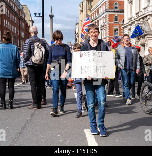 London, UK. 23rd Mar 2019. A Young protestor holds the banner 'Brexit is Bullshit' during the People's Vote march in London. Credit: AndKa/Alamy Live News - Stock Photo