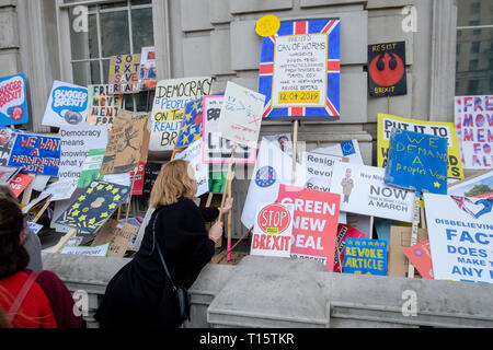 London, UK. 23rd March 2019. Hundreds of thousands of people march through central London demanding a second vote on the UK's membership of the European Union. Pictured: Marchers pile placards outside the front of the UK Government Cabinet Office in Whitehall. Credit: mark phillips/Alamy Live News - Stock Photo