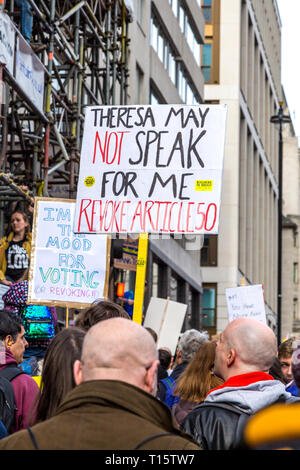 London, UK. 23rd Mar 2019.  Over a million people march for the People's Vote, for a second referendum on Brexit, sign saying 'Theresa May not speak for me, revoke article 50' Credit: Nathaniel Noir/Alamy Live News - Stock Photo