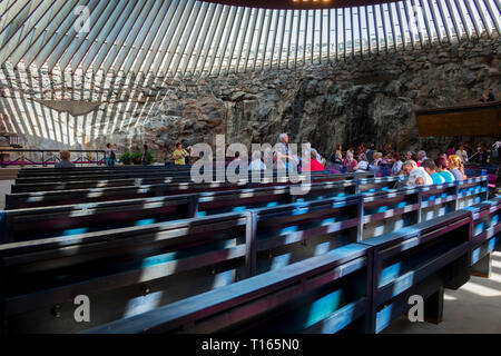 Interior view of the partially underground, rock-carved Temppeliaukio church in Helsinki, Finland. The Lutheran church has a natural appearance. - Stock Photo