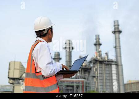 Engineer in uniform and helmet on of background the construction site - Stock Photo