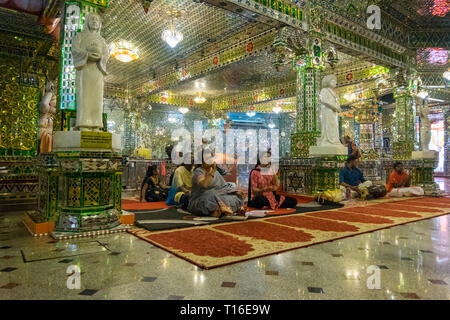 The unique Arulmigu Sri Rajakaliamman Glass Temple in Johor Bahru, Malaysia. The interior is completely covered in glass tiles. Singing. - Stock Photo