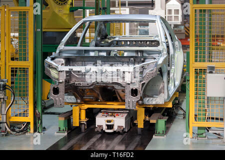Russia, Izhevsk - December 15, 2018: LADA Automobile Plant Izhevsk, part of the AVTOVAZ Group. Frame construction of the car in the welding shop. - Stock Photo