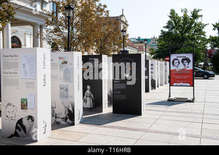 Warsaw, Poland - August 23, 2018: Old town street with signs for museum outdoor exhibit polonia open art stage with Chopin - Stock Photo