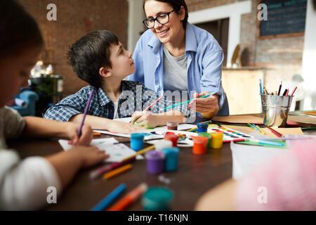 Female Art Teacher Working with Kids - Stock Photo