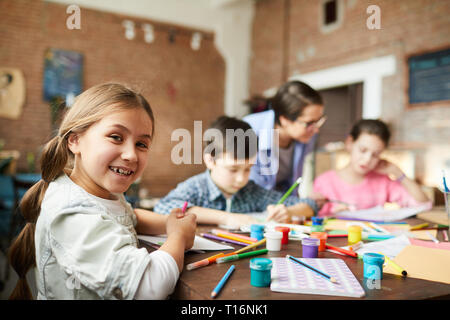 Little Girl Having Fun in Art Class - Stock Photo
