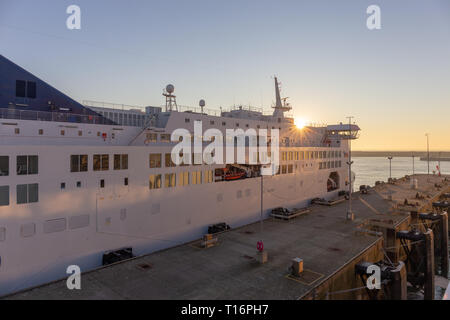 Dover, Kent, UK; 25th February 2019; Sun Rises Above a P&O Ferry Docked at the Port of Dover - Stock Photo