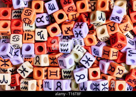 Multi-colored cubes with zodiac signs close-up. - Stock Photo