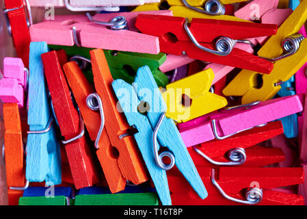 Color bright wooden clothespins close-up. - Stock Photo