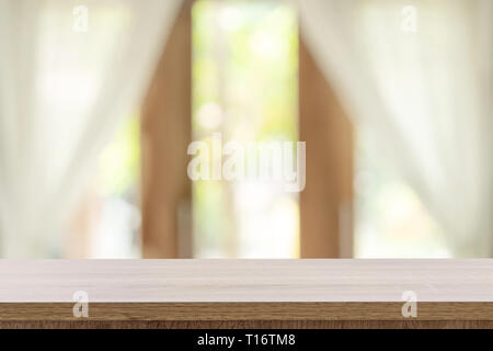 Empty wooden table and blur window background with copy space, display montage for product. - Stock Photo