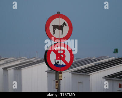 Oostende, Belgium - 7 August 2018: Two signs indicating a ban on swimming in the water and entering the beach with a dog. - Stock Photo