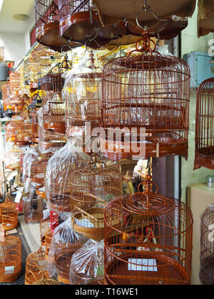 Kowloon, Hong Kong - November 3, 2017: Several bird cages are offered for sale at the bird market at Yuen Po Street Bird Garden. - Stock Photo