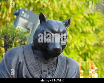 Kowloon, Hong Kong - November 03, 2017: A close up of one of the 12 zodiac statues in the Wong Tai Sin temple in Hong Kong. - Stock Photo