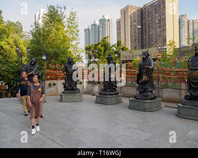 Kowloon, Hong Kong - November 03, 2017: An image of visitors to the zodiac statues in the Wong Tai Sin temple in Hong Kong. - Stock Photo