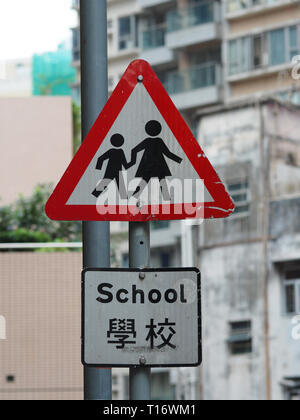 Central, Hong Kong - November 8, 2017: A traffic sign indicates a school environment in Hong Kong, the word school is mentioned in both English and ca - Stock Photo