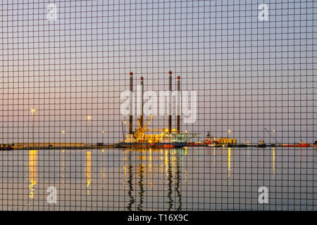 December 29, 2018 - Abu Dhabi, UAE: Offshore oil rig through the fence at Zayed Port, UAE - Stock Photo
