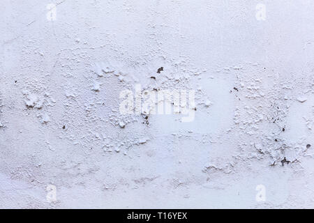 plain old aged white colored painted faded weathered peeled textured pattern on plastered concrete house wall surface background. Detailed backdrop, a - Stock Photo