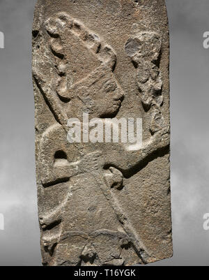 Close up of Hittite monumental relief sculpture ofa God probably holding lightning rods. Late Hittite Period - 900-700 BC. Adana Archaeology Museum, T - Stock Photo