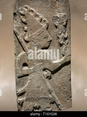 Hittite monumental relief sculpture ofa God probably holding lightning rods. Late Hittite Period - 900-700 BC. Adana Archaeology Museum, Turkey. - Stock Photo
