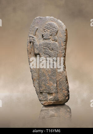 Hittite monumental relief sculpture of a figure holding a document. Adana Archaeology Museum, Turkey. - Stock Photo