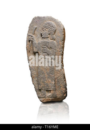 Hittite monumental relief sculpture of a figure holding a document. Adana Archaeology Museum, Turkey. Against a white background - Stock Photo