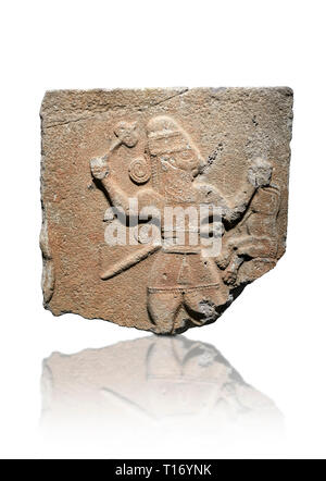 Hittite monumental relief sculpture of a man with an axe in one hand about to use it to kill a lion he is holding updide down in his other hand. Late  - Stock Photo