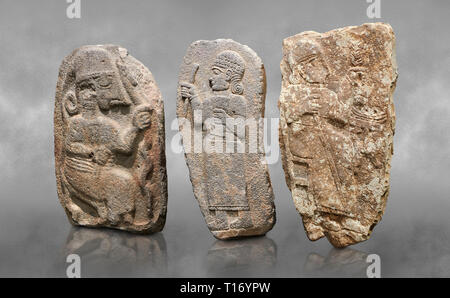 Hittite monumental relief sculptures, 900 - 700 BC, from Adana Archaeology Museum, Turkey. Against a grey art background - Stock Photo