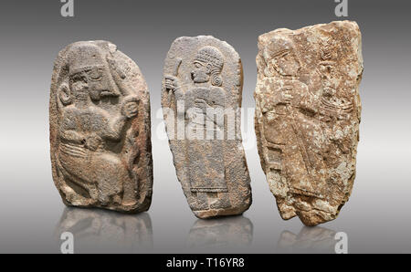 Hittite monumental relief sculptures, 900 - 700 BC, from Adana Archaeology Museum, Turkey. Against a grey background - Stock Photo