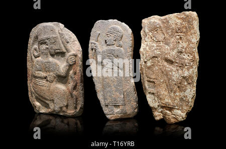 Hittite monumental relief sculptures, 900 - 700 BC, from Adana Archaeology Museum, Turkey. Against a black background - Stock Photo
