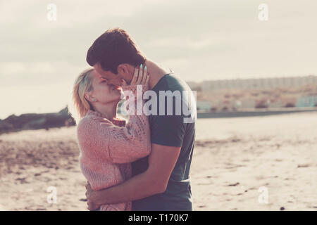 Love and passion for young caucasian couple boy and girl together at the beach in outdoor leisure vacation activity - honeymoon and forever concept fo - Stock Photo