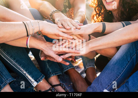 Happiness and cheerful lifestyle for team concept girls putting hands together for forever friends - happiness and friendship group of women smile and - Stock Photo