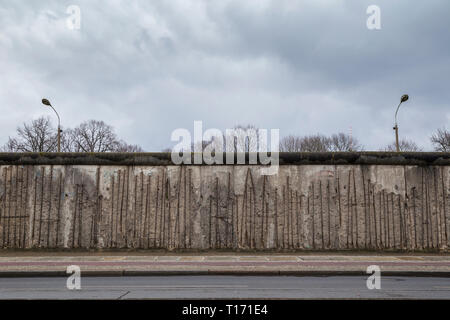 Front view of a section of the original Berlin Wall at the Berlin Wall Memorial (Berliner Mauer) in Berlin, Germany, on a cloudy day. Copy space. - Stock Photo