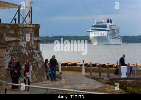 Cruise,Liner,ship,leaving,Southampton,people,watching,from,Pollution,Royal Yacht Squadron,Cowes,Isle of Wight, The Solent,UK, terminal,cruise,England, - Stock Photo
