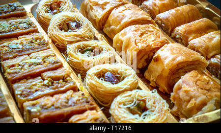 different type of arabian baklava in rows - borma nest ush-el-bul-bul asabi full screen - Stock Photo