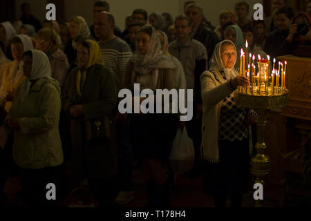 Belarus, Gomel, April 30, 2016. Nikolsky monastery.The celebration of Orthodox Easter. People in the temple near the lit candles. - Stock Photo