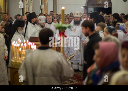Belarus, Gomel, May 01, 2016. Nikolsky monastery.Celebration of Orthodox Easter.Crowd of people, priest on the church service in the temple - Stock Photo