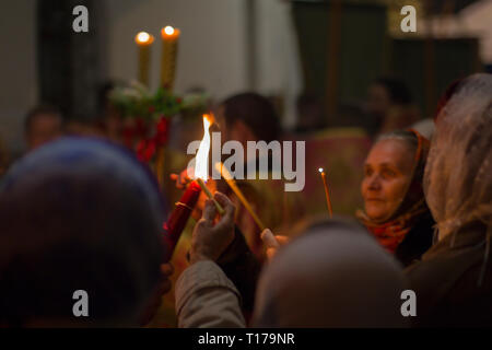 Belarus, Gomel, May 01, 2016. Nikolsky monastery.Celebration of Orthodox Easter.People in the church near the candles. Holy fire - Stock Photo